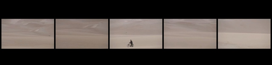 Identity of the Soul 5 screen film man with bicycle in desert